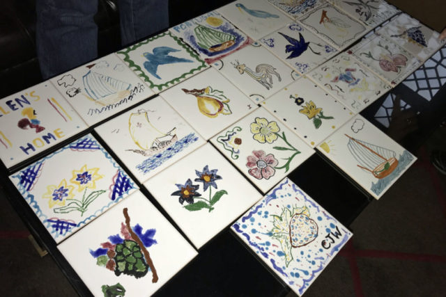 array of square tiles handpainted by tour members