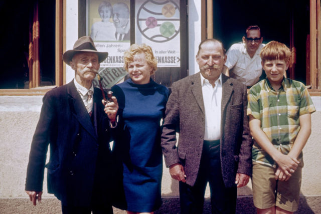 young rick steves with his parents and a man with a handlebar moustache
