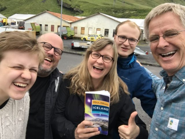 rick steves and tourists holding rick steves iceland guidebook