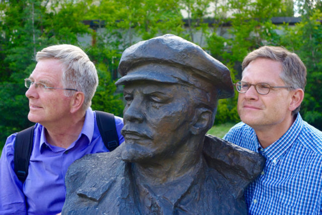 rick steves and cameron hewitt with lenin statue