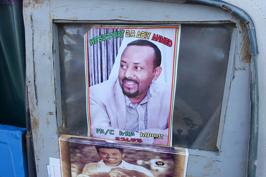 "picture of dr. abiy ahmed, the prime minister of ethiopia, with text that says ""we support dr. abiy ahmed"" - it is a poster"